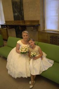 Mature bride with bridesmaid at her Stratford-Upon-Avon wedding dress