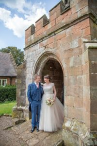 Alternative lace wedding dress with satin waist belt from Warwickshire wedding dress shop
