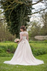 Alternative designer wedding dress with keyhole back