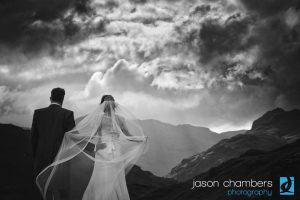 Dramatic black and white wedding photography at outdoor UK wedding