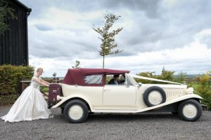 Amy and Josh's red and cream wedding transport
