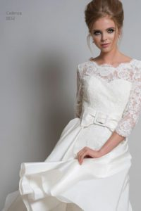 Sleeved lace bridal gown with oversized bow belt in Warwickshire
