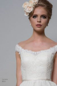 Lace wedding dress with bateau neckline