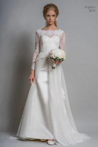 Sleeved wedding dress with sweetheart neckline at bridal boutique in Warwickshire