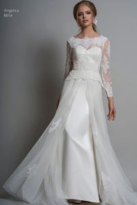 Lace and satin sleeved wedding dress with sweetheart neckline at bridal boutique in Warwickshire