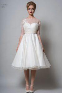 Sleeved, T-length wedding dress by Louise Bentley at Warwickshire wedding dress shop