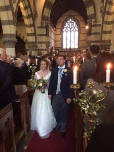 Boho Bride wearing off-the-shoulder wedding dress at church wedding in Stratford-Upon-Avon
