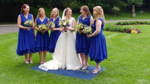 Bride with her bridesmaids in royal blue bridesmaid dresses