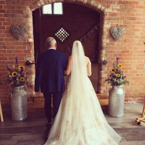 Bride wearing boho bride wedding dress from Stratford Upon Avon