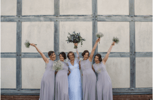 Bride and bridesmaids celebrating wedding