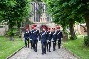 Groom and groomsmen exiting the church wedding ceremony in Stratford-Upon-Avon
