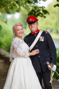 Mature bride at her Stratford-Upon-Avon wedding wearing a sleeved lace wedding dress