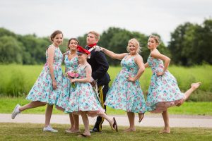 Bridesmaids wearing floral blue bridesmaid dresses from Boho Bride in Stratford-Upon-Avon