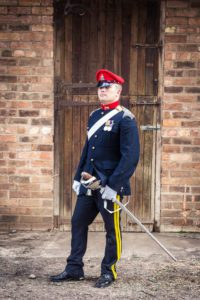 Groom stood outside church wedding ceremony in Stratford