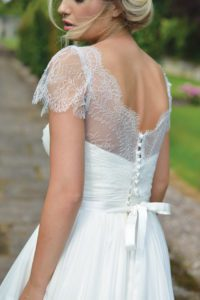 Designer sleeved wedding dress by Ivory and Co at Boho Bride boutique in Stratford Upon Avon, Warwickshire