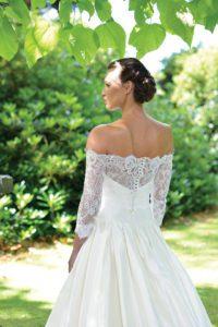 Designer sleeved, off-the-shoulder wedding dress by Ivory and Co at Boho Bride boutique in Stratford Upon Avon, Warwickshire