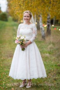 Sleeved lace wedding dress at boutique in Stratford-Upon-Avon