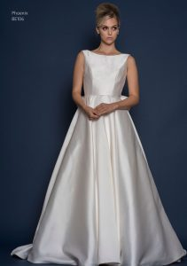 A-line satin wedding dress by designer Louise Bentley