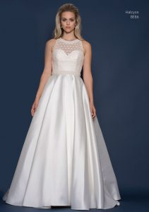 Satin wedding dress at bridal boutique in Stratford Upon Avon