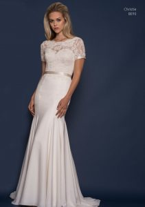 Wedding dress by Louise Bentley with sleeves and a belt