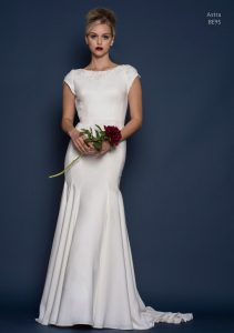 Louise Bentley designer lace wedding dress with cap sleeves and a fitted and fishtail design