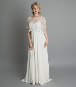 Model wearing bohemian wedding dress and bolero from the Freedom Collection at a bridal boutique in Warwickshire