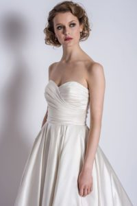 Strapless satin wedding dress with a sweetheart neckline. Dress by Loulou Bridal
