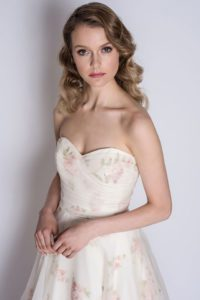 Strapless designer wedding dress with a sweetheart neckline and rose print