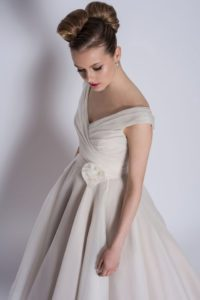 Long ivory wedding dress with rose on belt