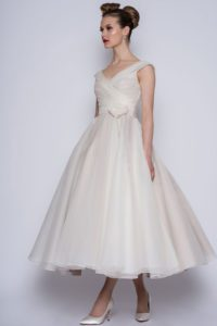 T-length wedding dress by Loulou Bridal with rose on belt