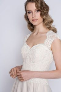 Lace wedding dress with thick straps by Loulou Bridal
