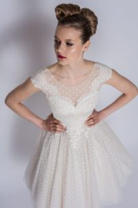 Summer wedding dress with V-neckline by Loulou Bridal at Boho Bride Boutique in Stratford