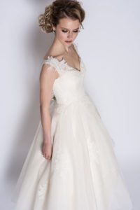 Loulou Bridal lace wedding dress with V-neckline and lace details on straps