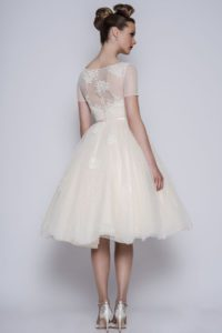 Short wedding dress with sheer back by Loulou Bridal