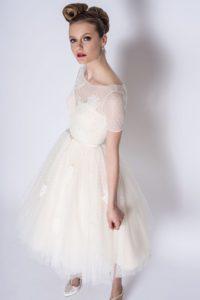 Short designer wedding dress with sleeves and belt