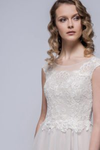 Long lace wedding dress by Loulou Bridal bridal gowns