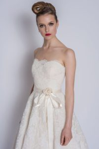 Wedding dresses with belt and bow by Loulou Bridal at bridal boutique in Stratford