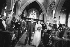 Bride walking down the aisle at her church wedding ceremony in Stratford Upon Avon