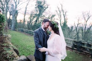 Bride wearing sleeved wedding dress from Boho Bride