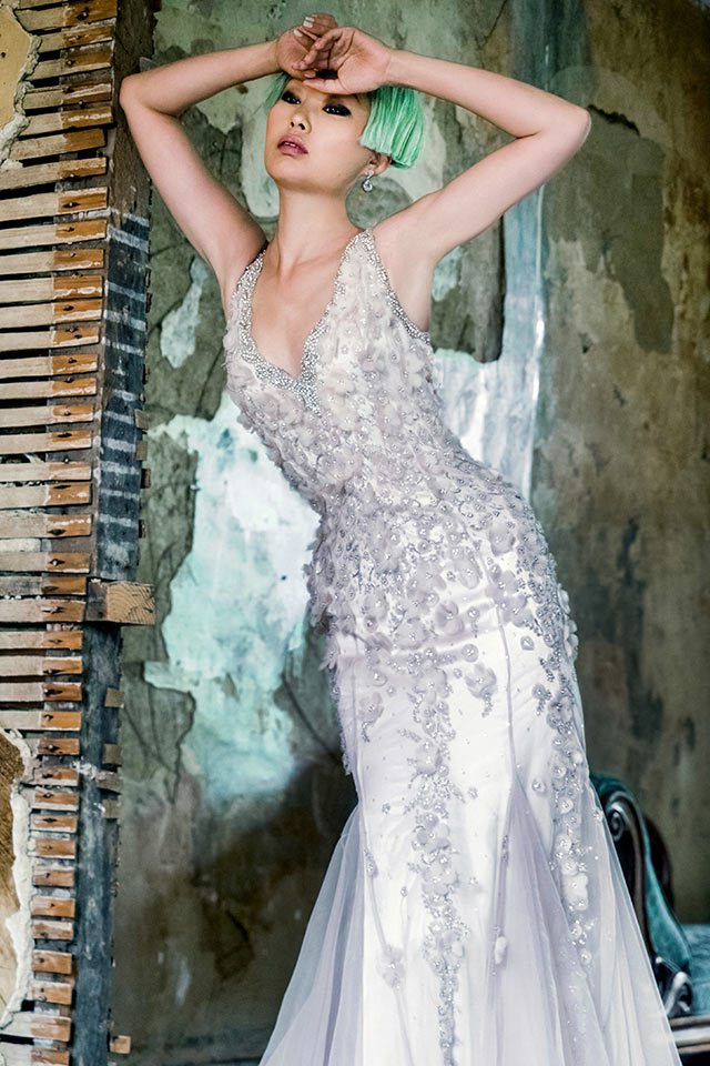 Elaborately designed silver coloured wedding dress with unique lace features, a plunging neckline and open back with keyhole feature back in Warwickshire, UK