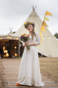 A bohemian bride wearing a wedding dress from Boho Bride's Freedom collection at her tipi wedding in Stratford Upon Avon. Boho Bride's Freedom Collection is made up of wedding dresses that gives brides the freedom to mix and match each component of their wedding dress to create the ultimate, figure-flattering and unique design