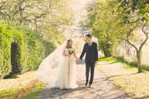 Chiffon wedding dress with elegant veil from wedding dress shop in Stratford-Upon-Avon