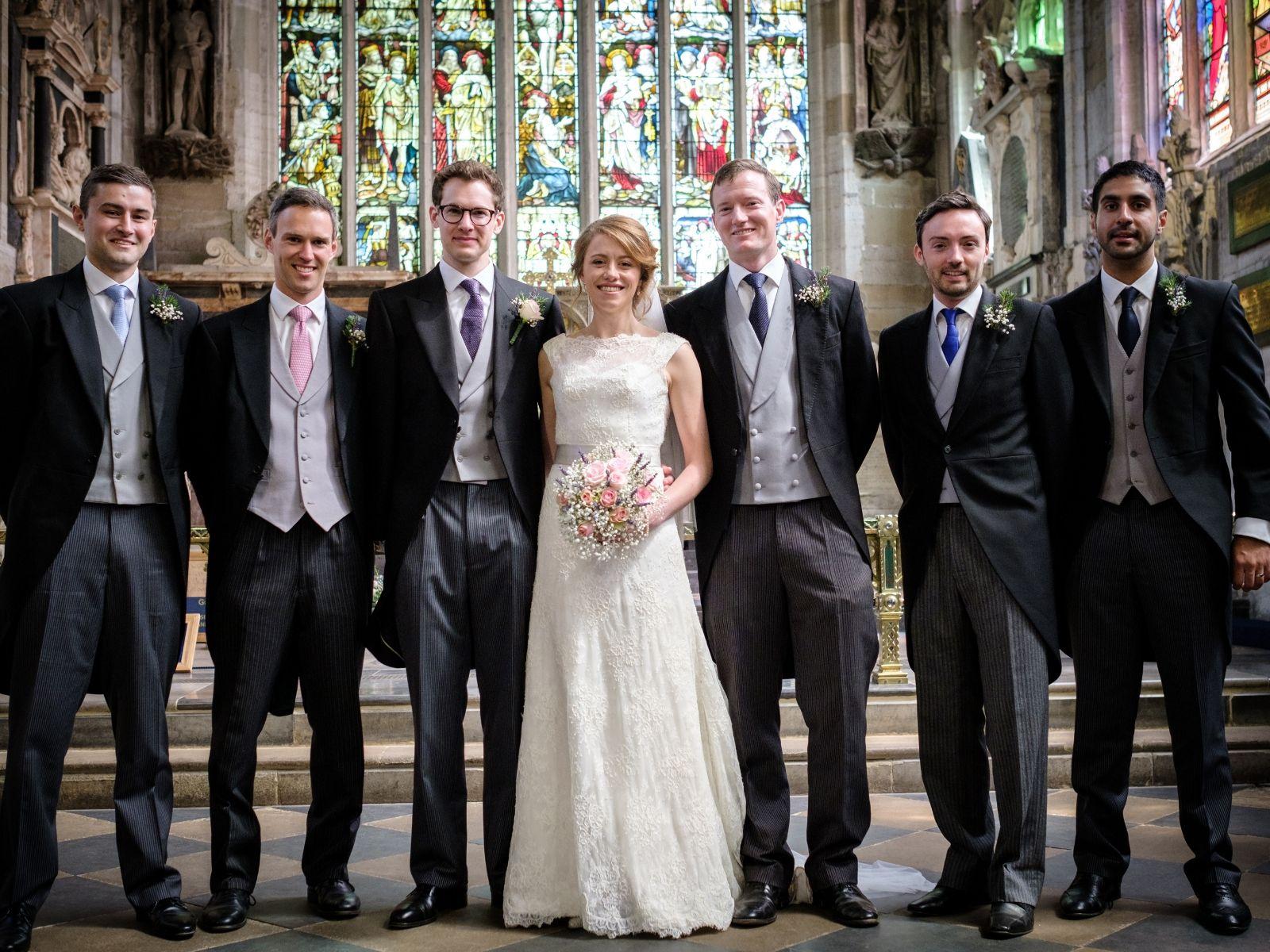 Boho Bride Harriet with her groomsmen at church wedding