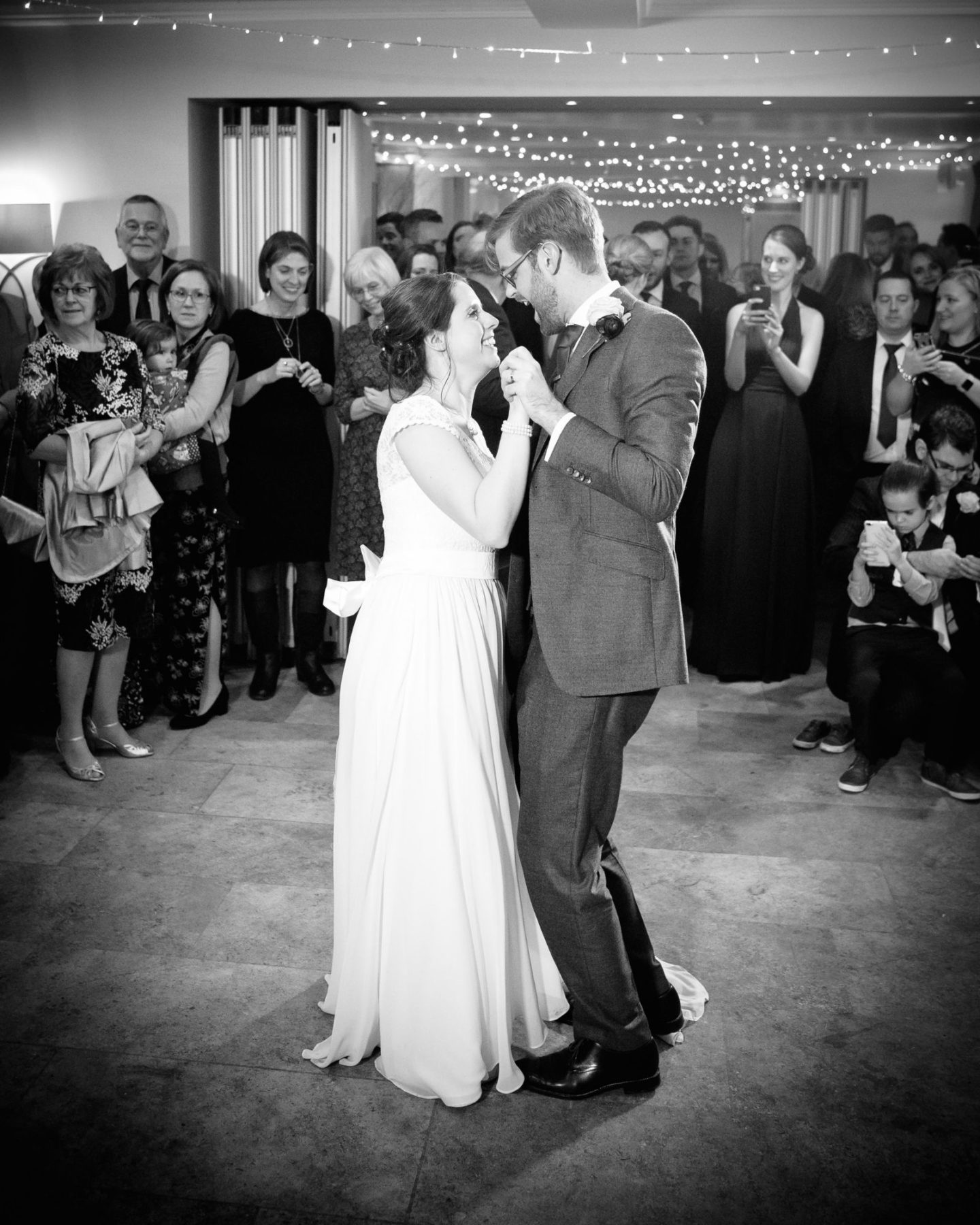 Newly married couple dancing on wedding day