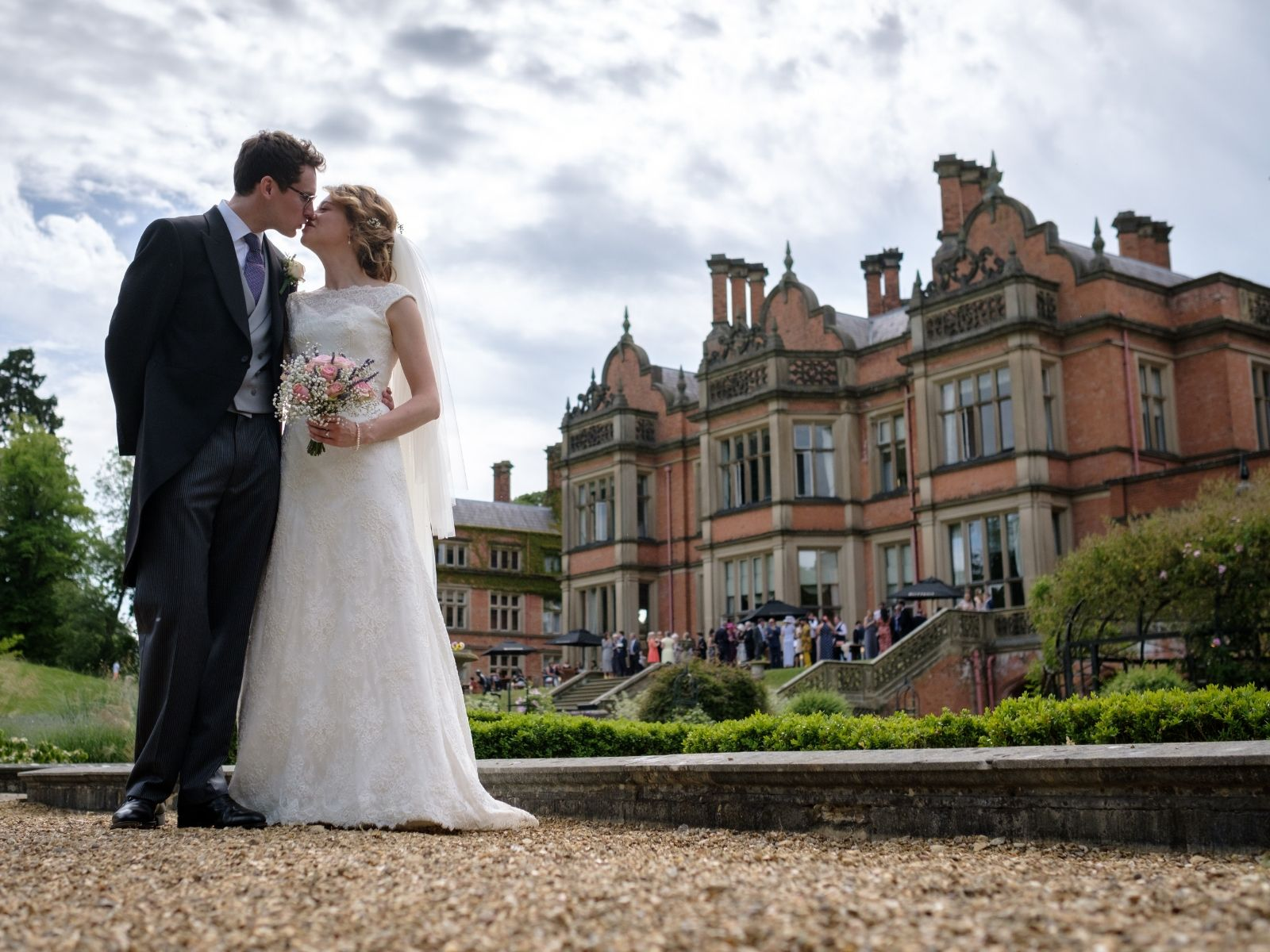 Couple stood outside at wedding at Welcombe Hotel