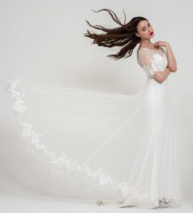 Loose, summer, boho wedding dress with flutter sleeves and an open back in Stratford-Upon-Avon, UK