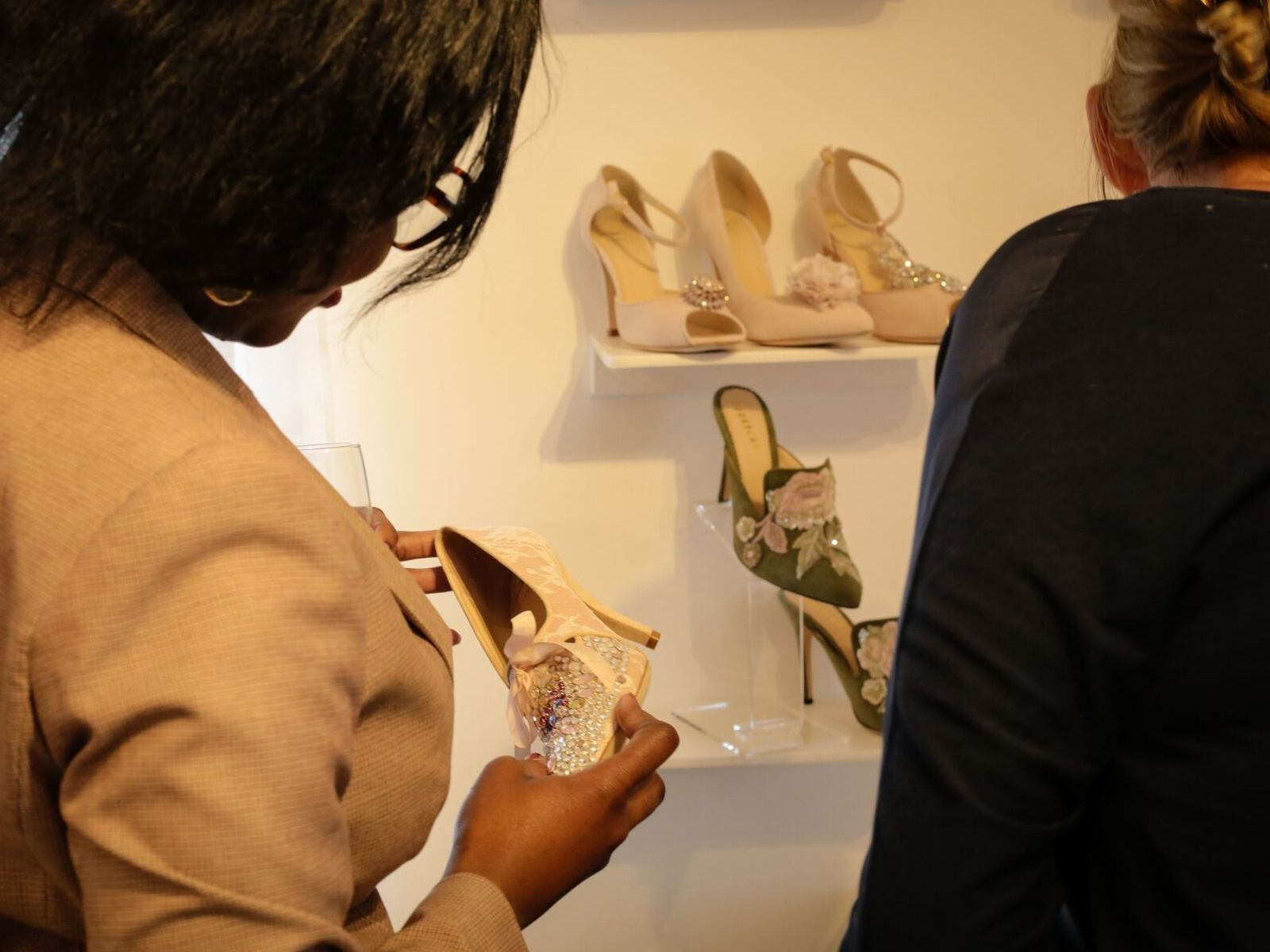 Customers looking at Di Hassall designer bridal shoes in Boho Bride Boutique