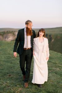Lace bridal biker jacket and bohemian wedding dress from Warwickshire wedding dress shop