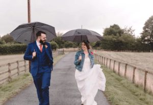 Bride wearing boho wedding dress with denim jacket