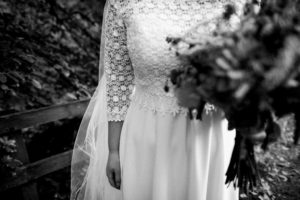 Bespoke, lace wedding dress with sleeves and a long train. Wedding dress designed and created by Lola and Em bridal designers from Warwickshire in association with Boho Bride Boutique in Stratford Upon Avon